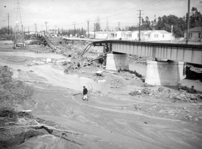 A person walks in the riverbed near a collapsed bridge after the flood of 1938 in North Hollywood