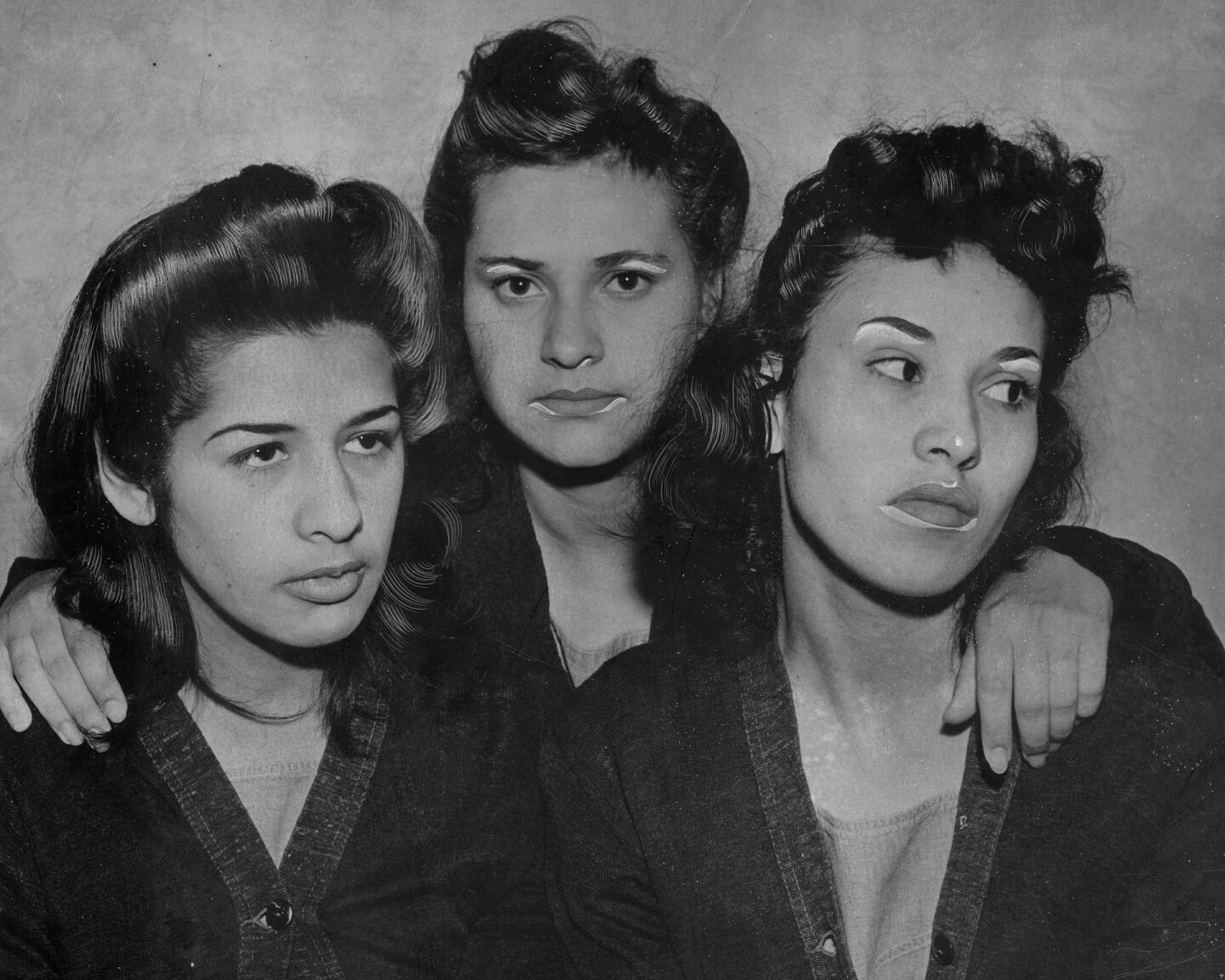 Alba Barrios, Francis Silva, and Lorena Encinas, held in prison in connection with slaying during the Zoot suit period, 1942.