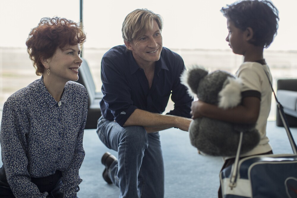 "Nicole Kidman (as Sue Brierley), David Wenham (as John Brierley) and Sunny Pawar (as a young Saroo Bierley) in the film ""Lion."""