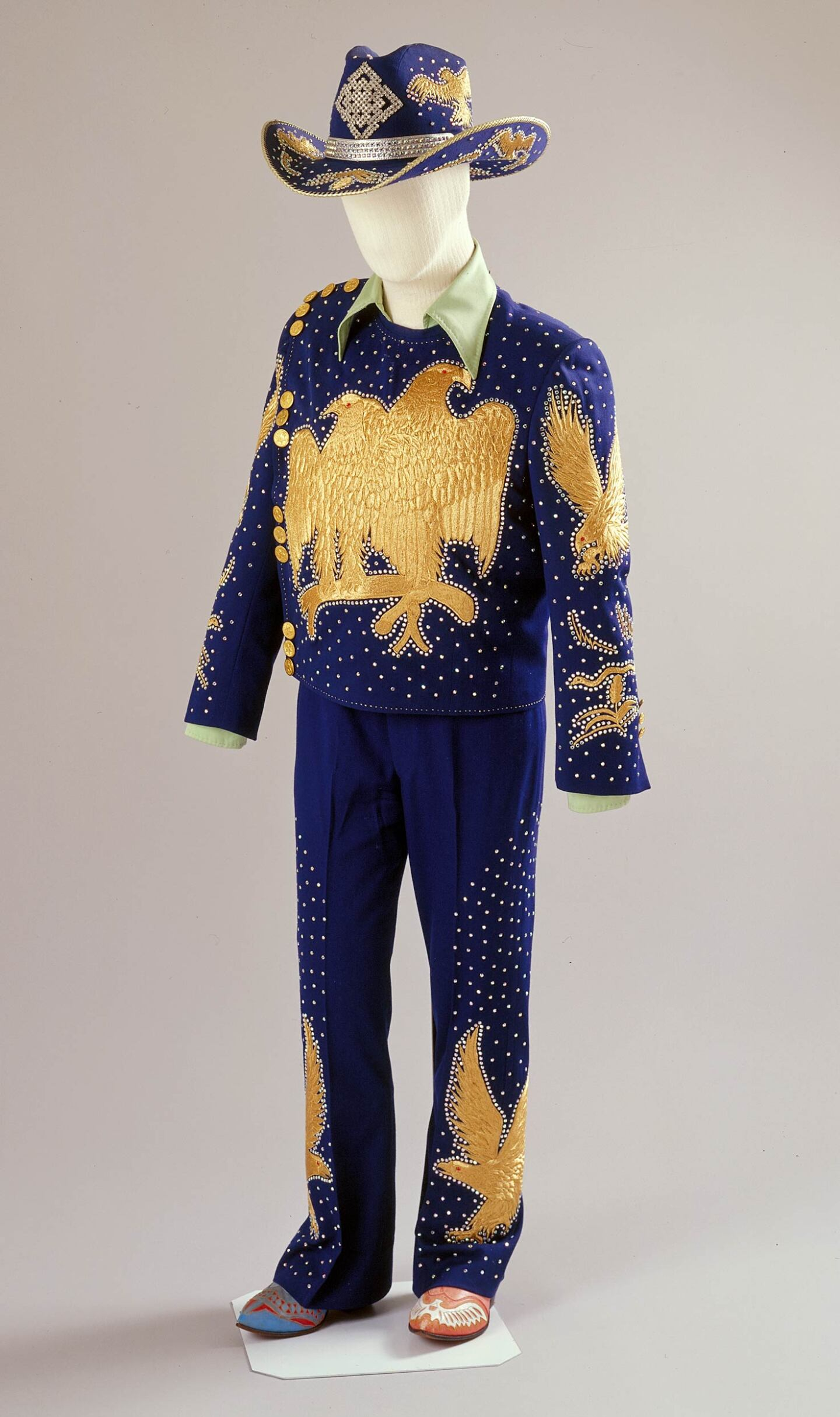 Nudie's outfit with rhinstones and embroidery along with his mismatched boots | Courtesy of the Autry Museum of the American West