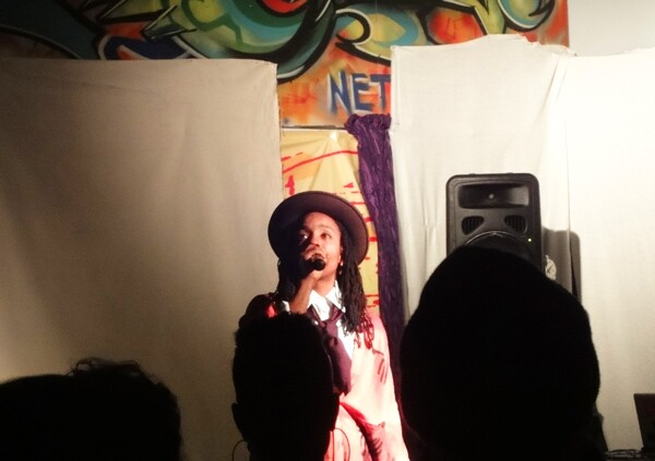 A young artist takes the stage at Bananas, an all ages event held every third Tuesday of the month at KAOS Network. Photo: Nathalia Morales-Evanks
