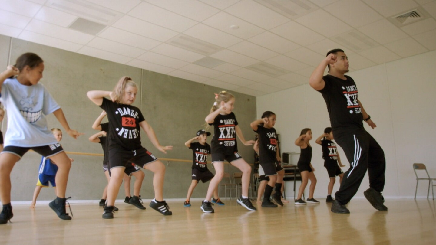 "William Rakena leading a dance class | Still from ""Both Worlds"""