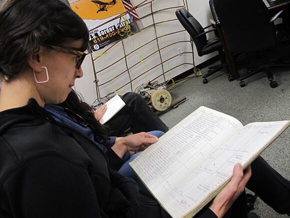 Eva Struble examines a Border Patrol log book from the 1973. | Photo: Jena Lee.