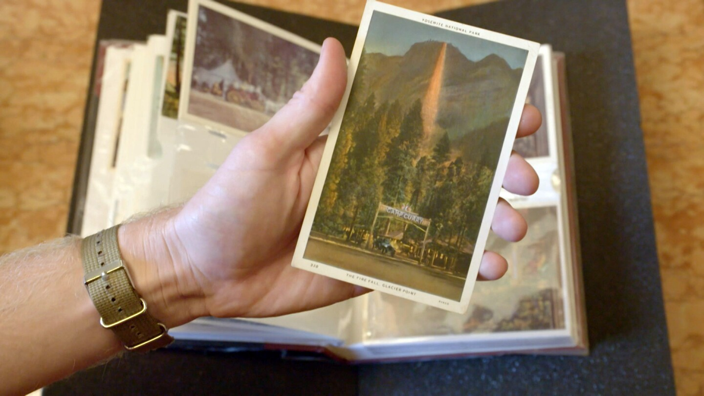 A hand holding postcards of Firefall in Yosemite | Still from Lost LA Season 3 Yosemite