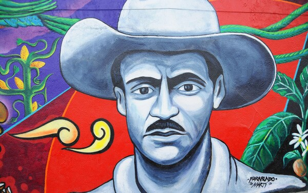A close up of the mural outside Antigua Coffee House