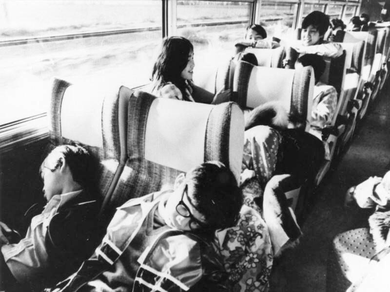 Children sleep and talk on a bus