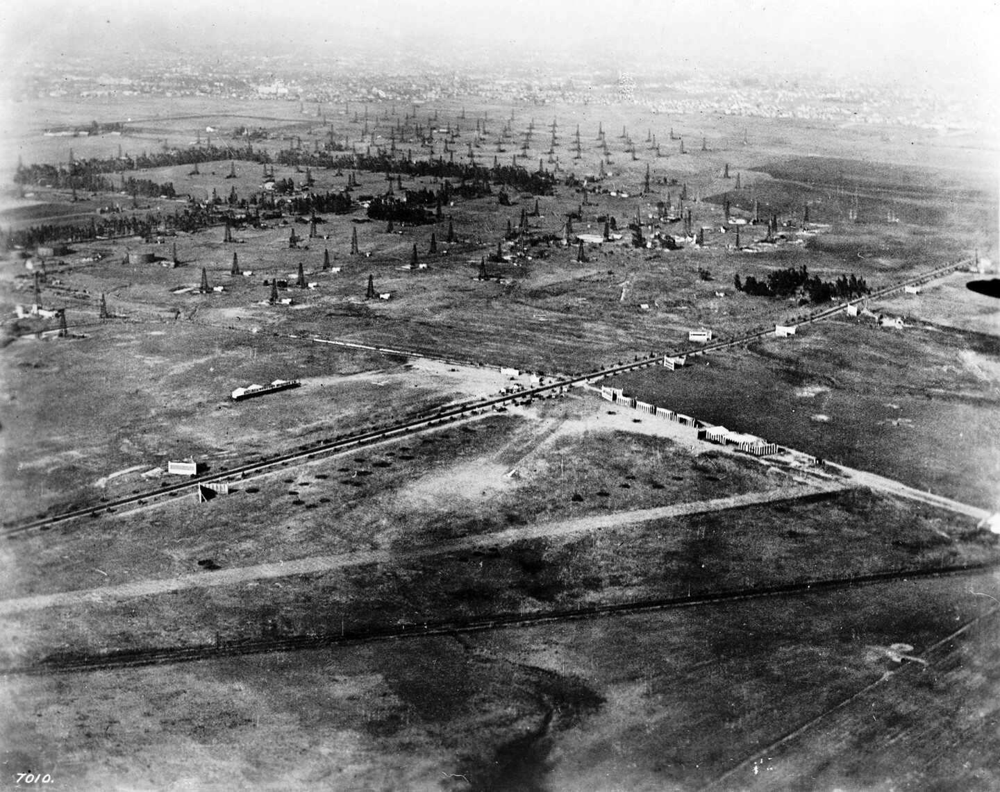 Aerial view of Wilshire Boulevard and Fairfax Avenue, showing Rogers Airport, 1920