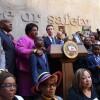 Governor Gavin Newsom at podium, signing Assembly Bill 392 into law