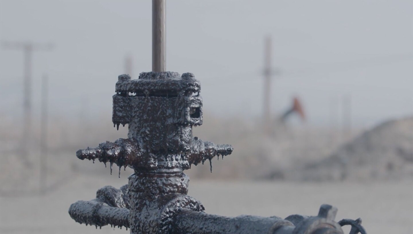"""Closeup shot of residue on oil pump jack. 