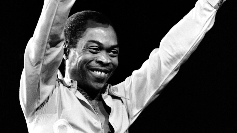 """Fela Kuti smiles as he raises his arms.   """"Finding Fela"""""""