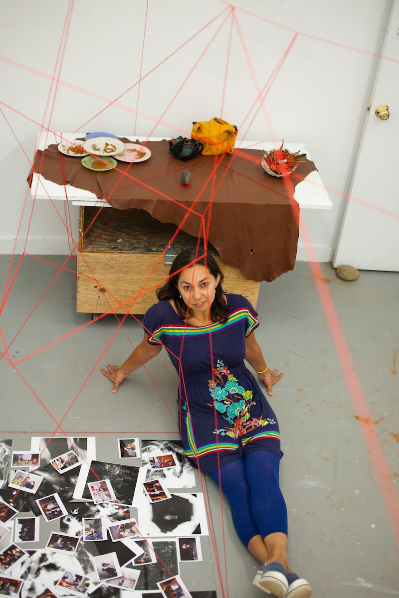 "Photographer Mercedes Dorame poses in front of her ""Coordinates"" installation."