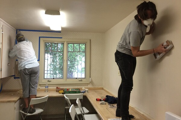 Women working to overhaul the WCCW space | Photo courtesy of Women's Center for Creative Work
