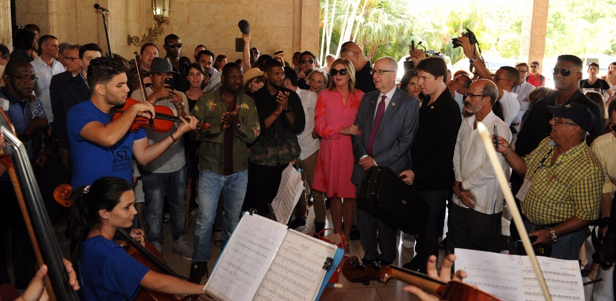 President's Committee delegation arriving in Cuba with Joshua Bell playing with Cuban students.   Courtesy of the President's Committee on the Arts and the Humanities