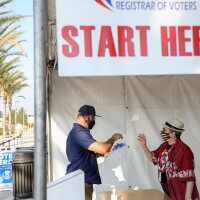 A voter signs-in to cast his ballot at the San Diego County Registrar of Voters on October 5, 2020 in San Diego, California , as early voting begins in California.   SANDY HUFFAKER/AFP via Getty Images
