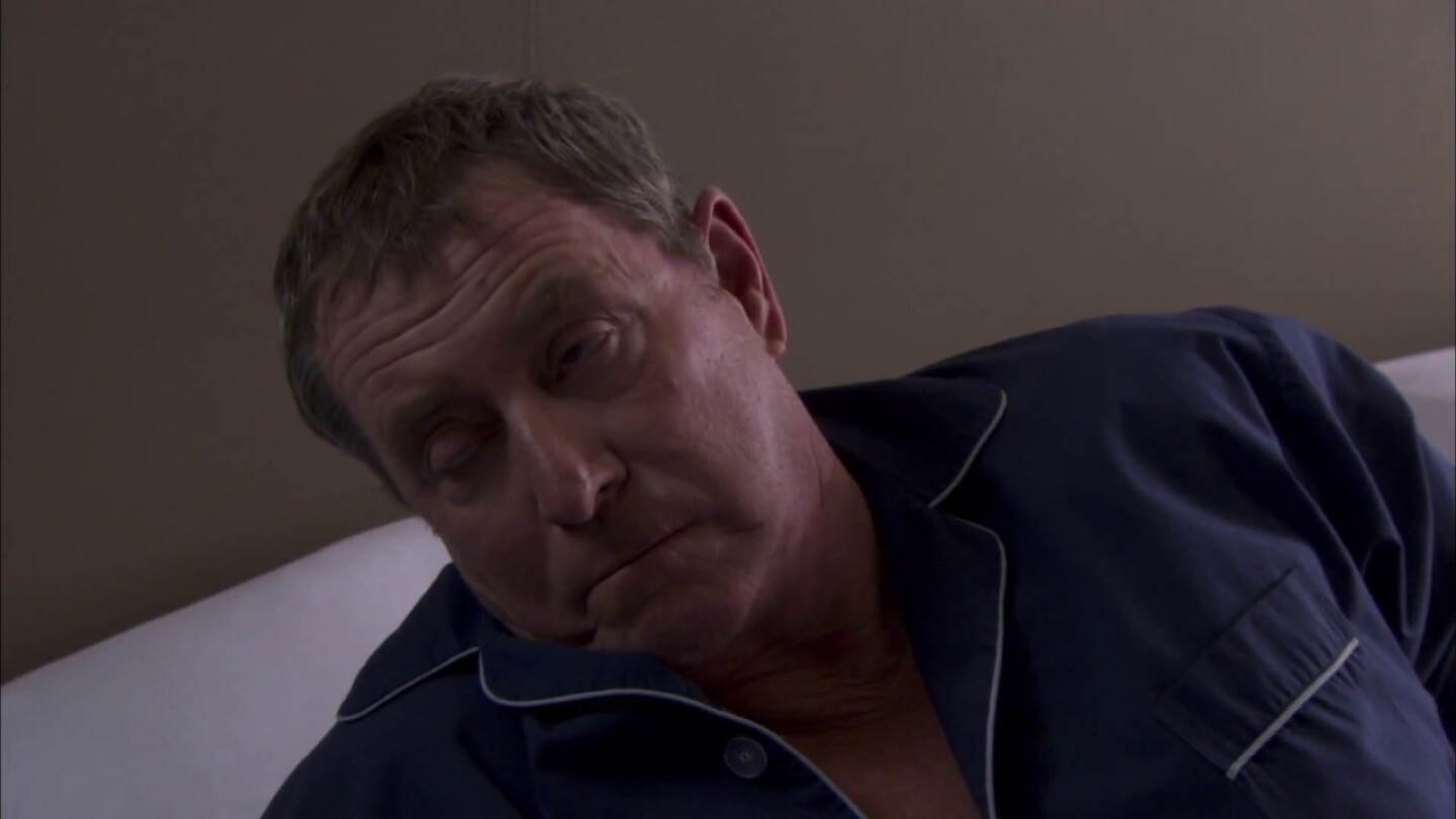 Scene from Midsomer Murders: John Nettle face that appears to be laying in bed