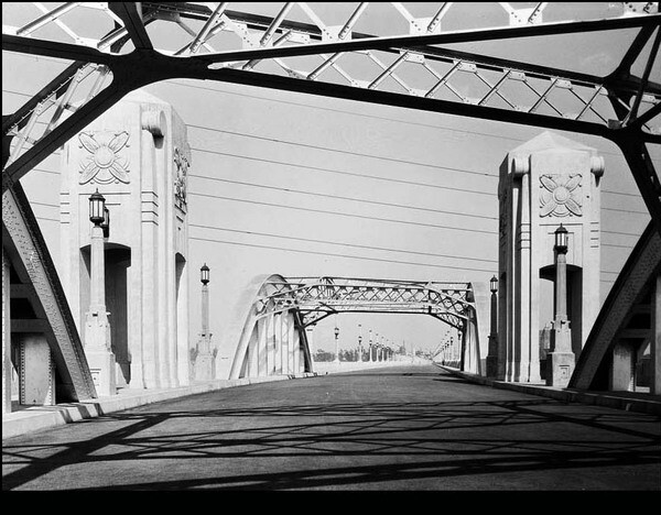 Two pylons were once next to the two 150-foot wide, asymmetrical steel through-arch spans. A few years after opening, they were removed when it was first learned the bridge's concrete was suffering from ASR I USC Libraries Special Collections