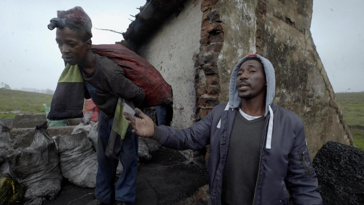 "A miner in South Africa retrieves coal from an abandoned mine (left) while an environmental activist describes his work (right). | Still from ""Earth Focus"""