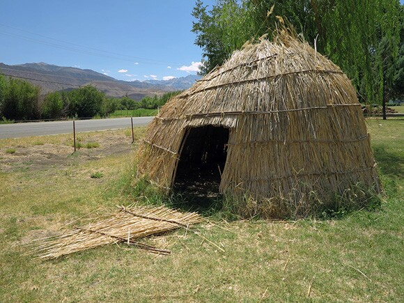 Outdoor exhibition of traditional thatched-hut in the front yard of The Owens Valley Paiute-Shoshone Cultural Center & Museum, Bishop, California. | Photograph by Tyler Stallings.