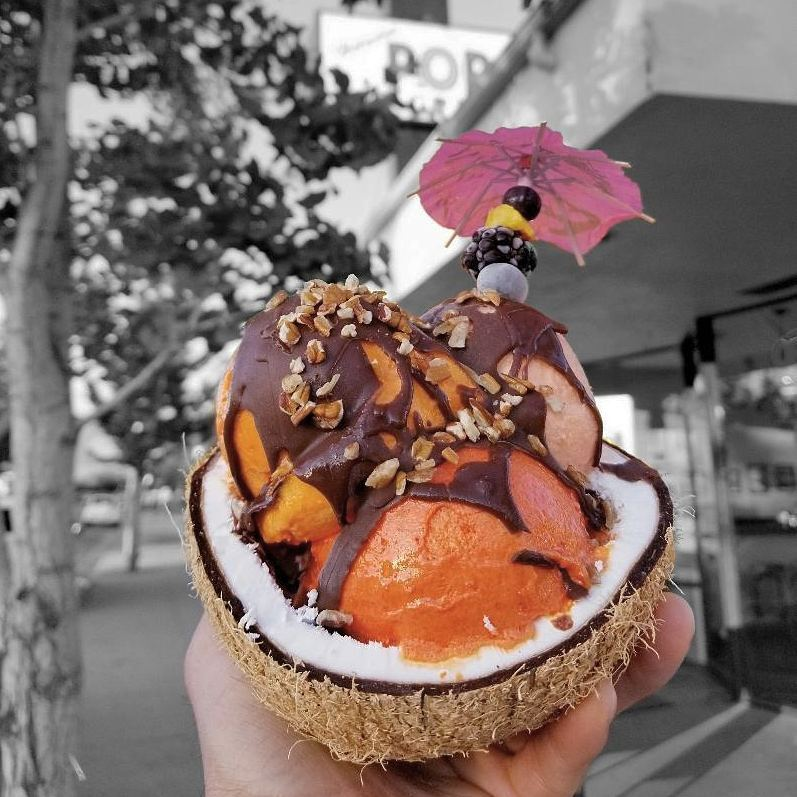 Lucuma, mamey, and pink guava ice cream in a coconut shell bowl   Courtesy of Helados Pops