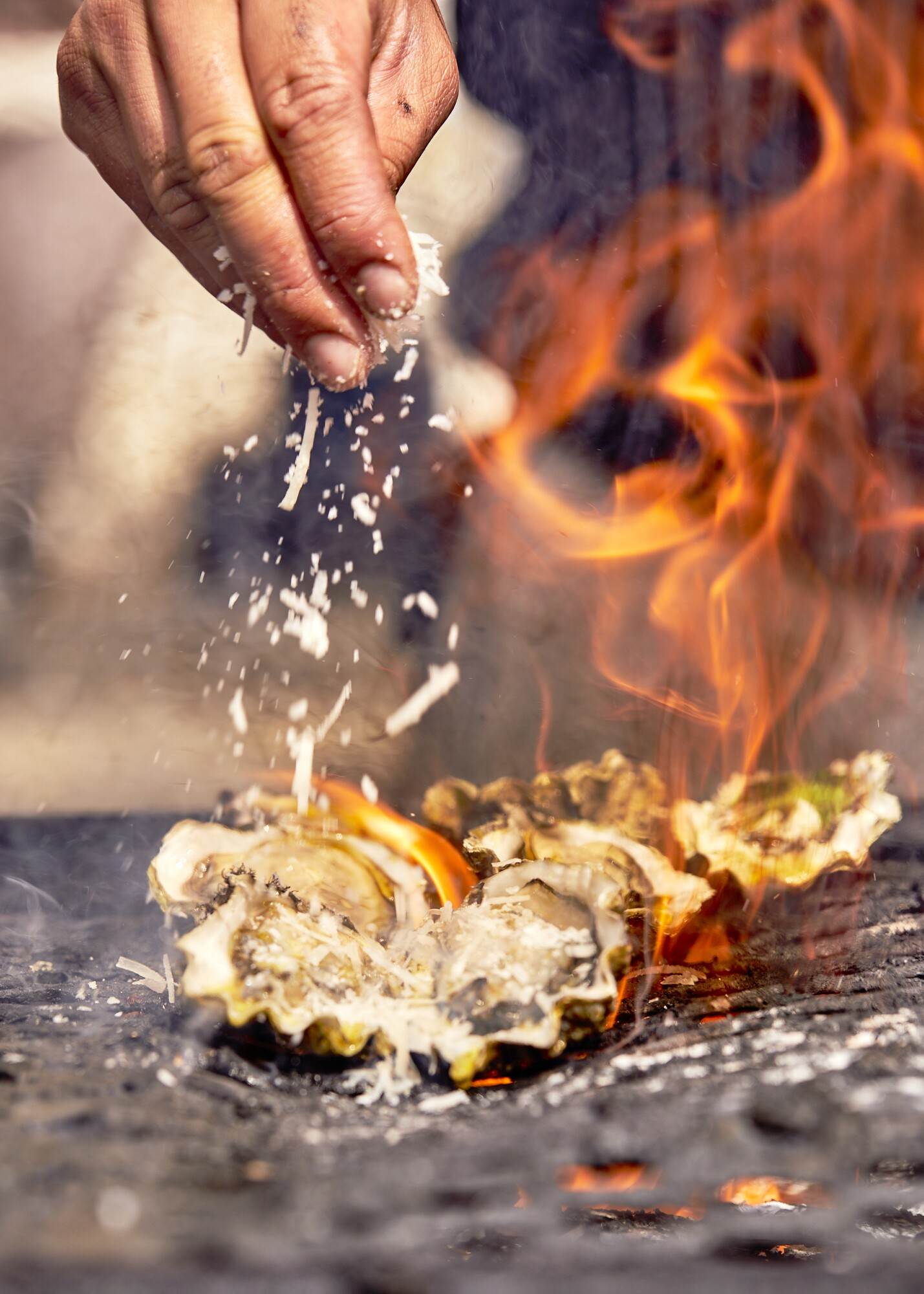 Oysters on the grill at the Manila District in downtown Los Angeles.