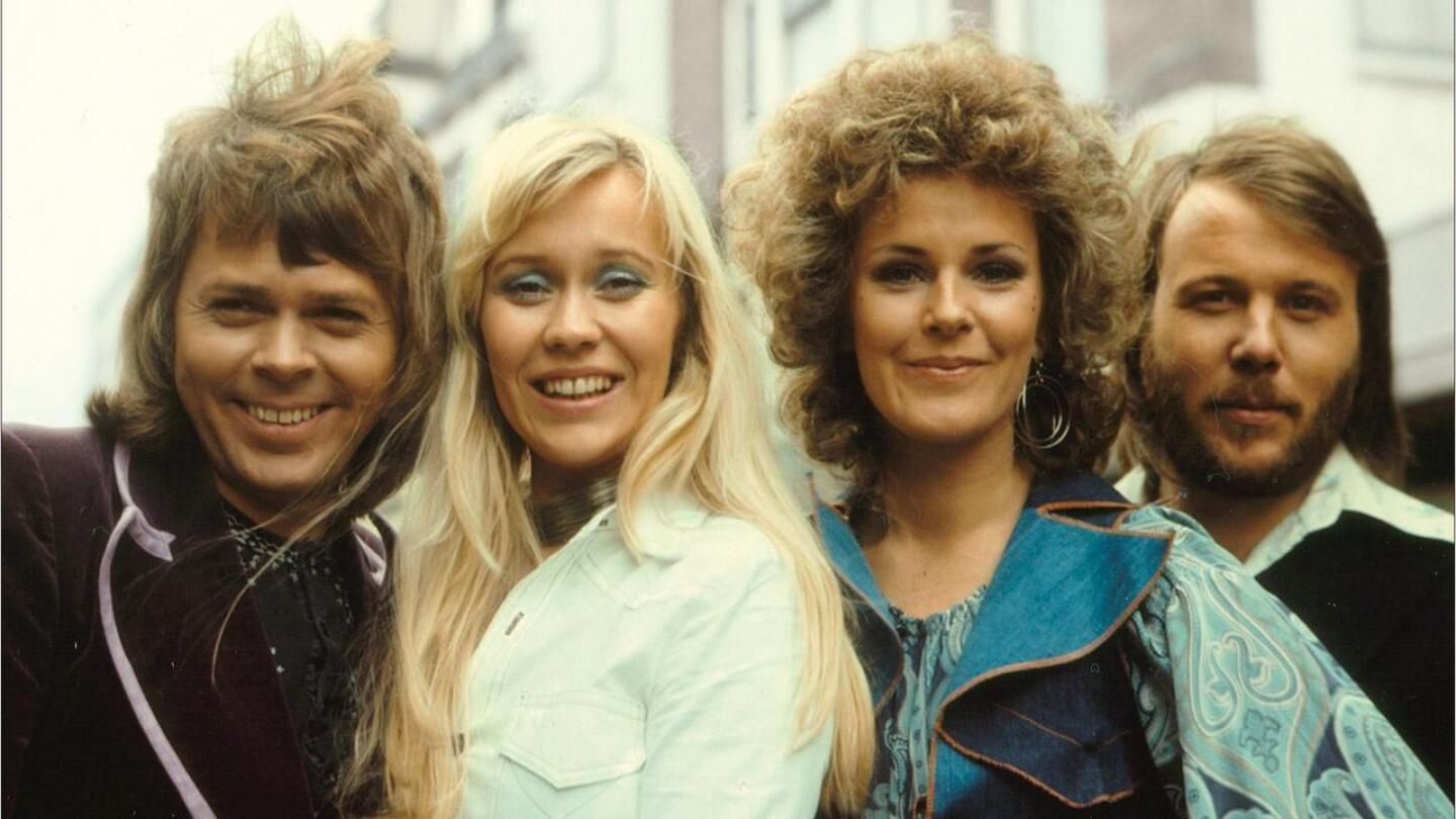 Members of ABBA pose for a picture.