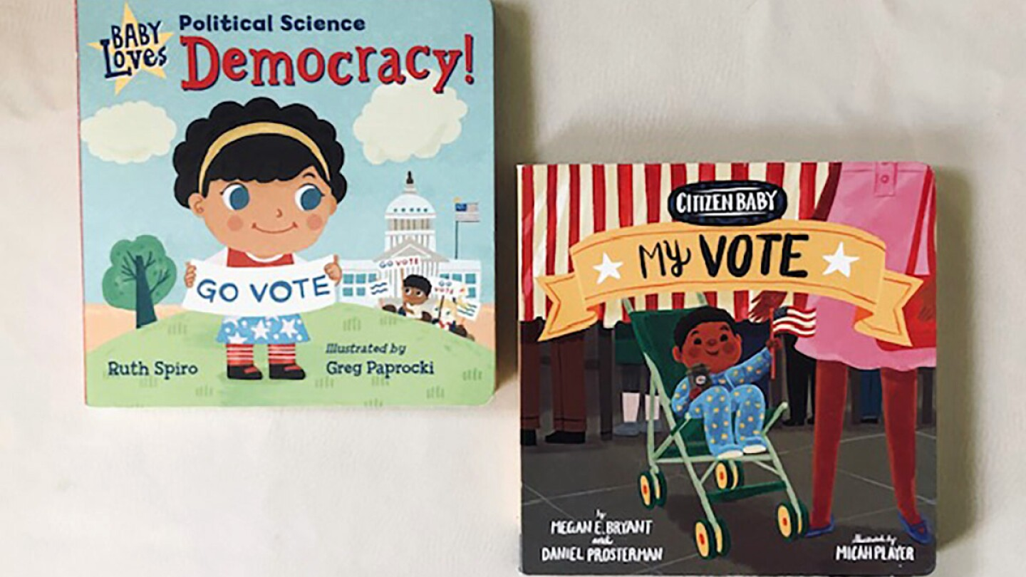 """Book covers of """"Baby Loves Political Science: Democracy!"""" featuring a small child cartoon holding a sign that reads """"go vote"""" and of """"Citizen Baby: My Vote"""" featuring a cartoon baby in a stroller."""