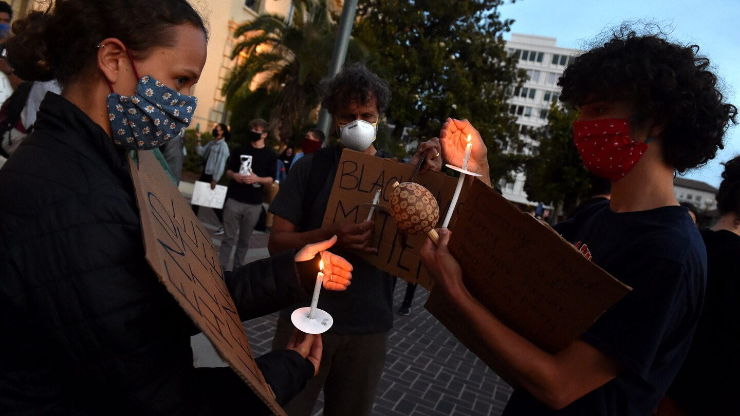 Protesters light candles during a candlelight vigil in front of Pasadena City Hall after the death of George Floyd, a black man who was in police custody in Minneapolis in Pasadena on Sunday, May 31, 2020. | (Photo by Keith Birmingham/MediaNews Group/Pasa