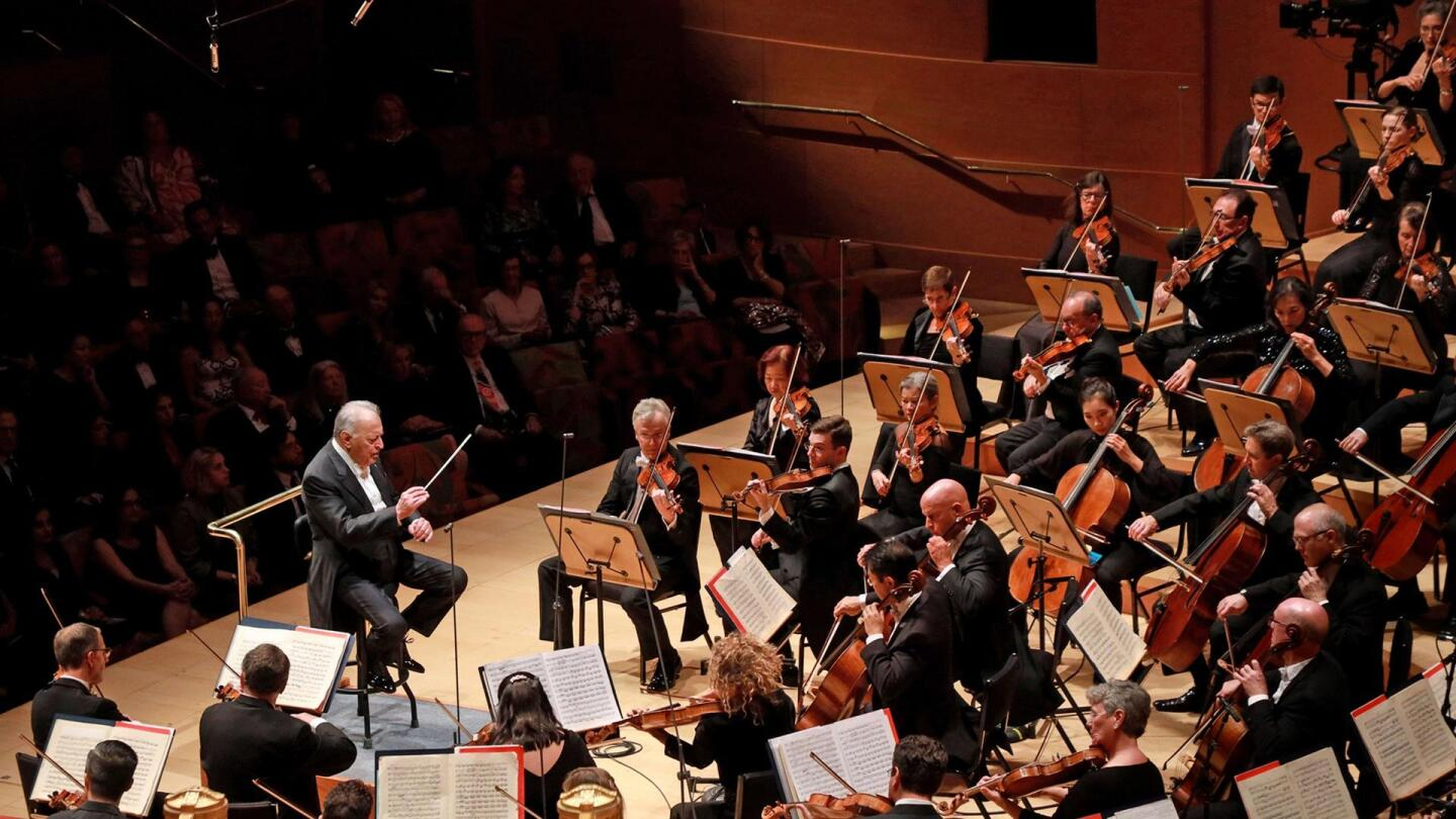 "An orchestra performs on stage. | ""Great Performances: LA Phil 100"""