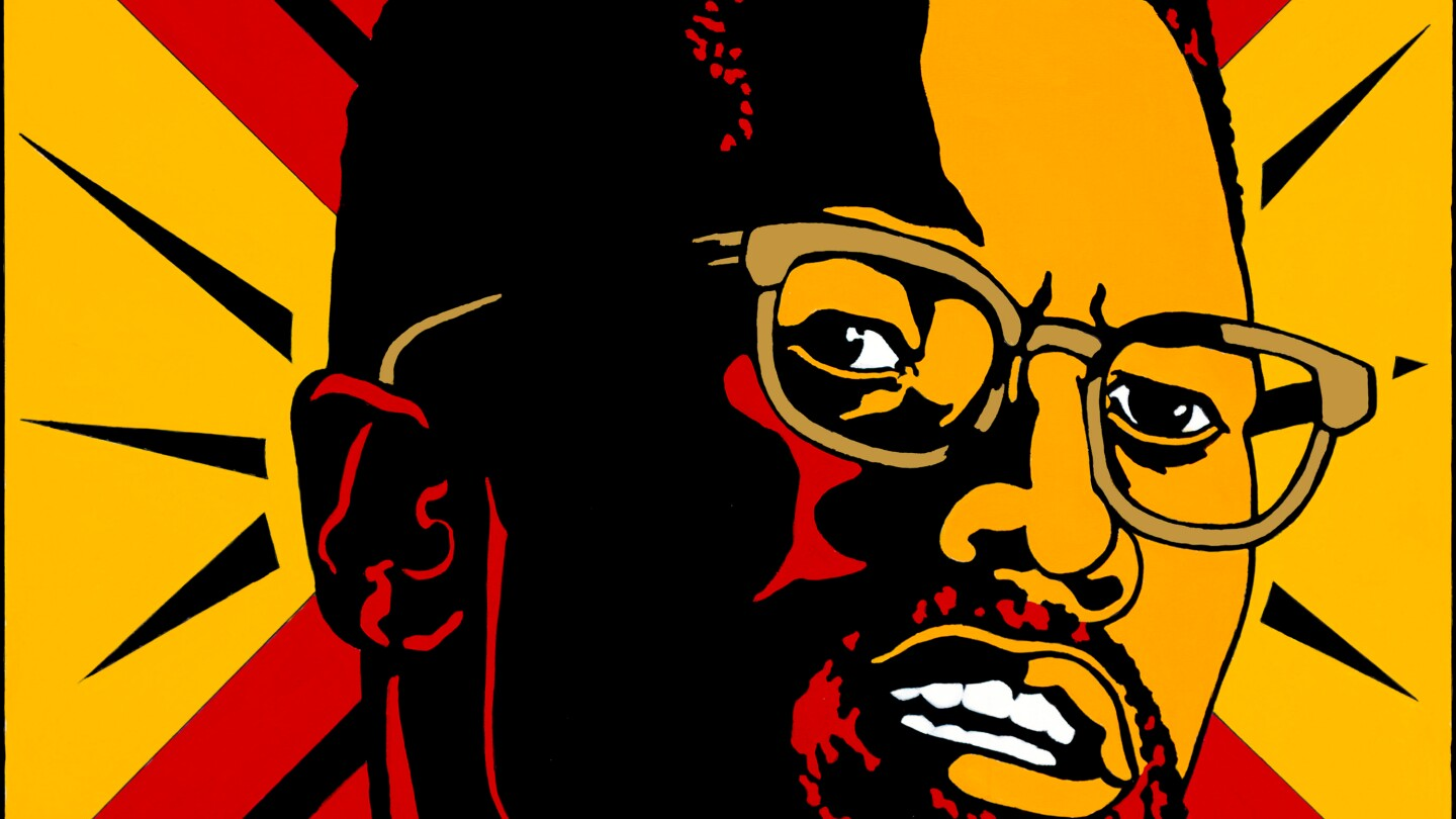 A graphic design poster of Malcolm X made by Emory Douglas.