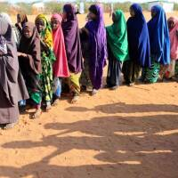 Somali internally displaced girls queue before getting into a classroom at a school beside an IDP camp in Dollow, Somalia April 4, 2017. | REUTERS/Zohra Bensemra