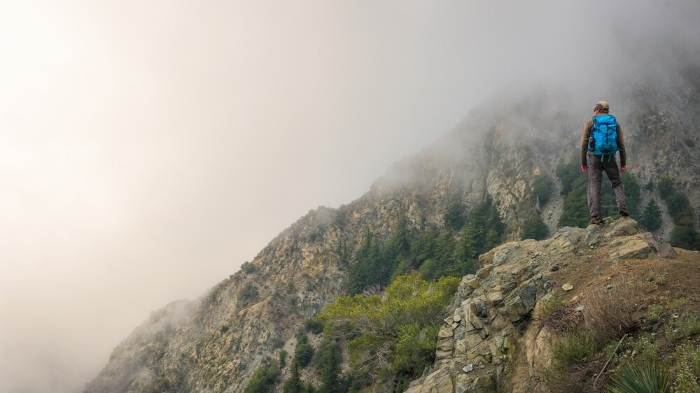Hiker contemplates the foggy abyss in the San Gabriels | Photo: Mason Cummings/The Wilderness Society