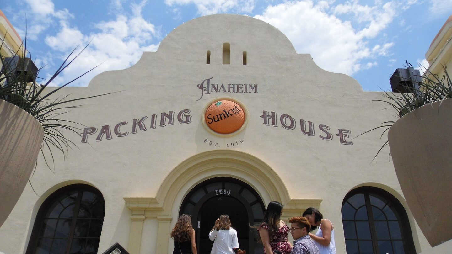 People walk in and out of the Anaheim Packing House.