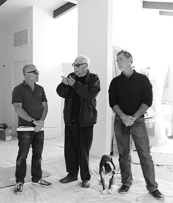 Menrad, Krisel, an unidentified Boston terrier, and Roberts observe the construction. | Photo: Patricia Peterson.
