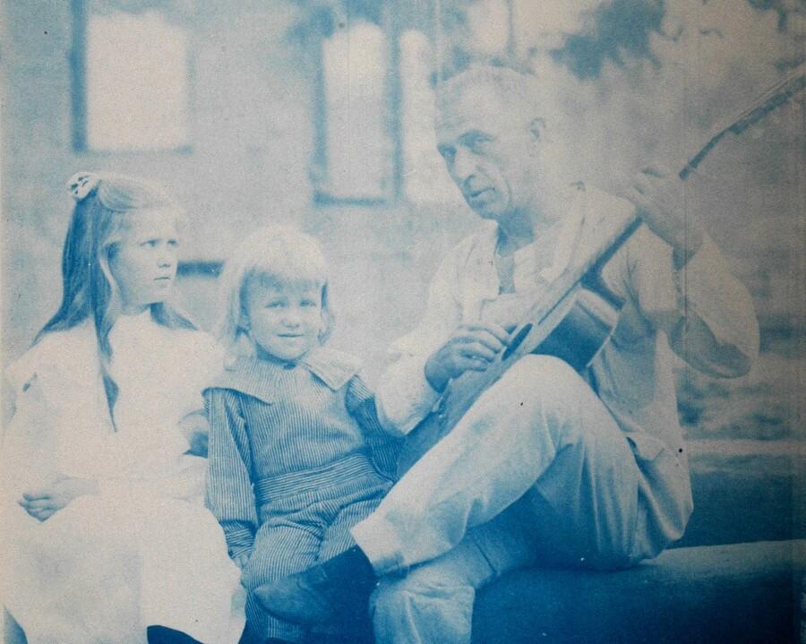 Charles Lummis with guitar