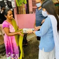 Aqsa Mushtaque (R) distributes sanitary pads in the slums of Kolkata, India on June 10, 2020.   Photo credit: Aqsa Mushtaque