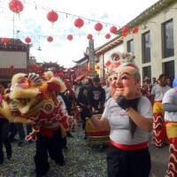 A lion dance troupe parades through L.A.''s Chinatown as part of the Chinese New Year celebration.