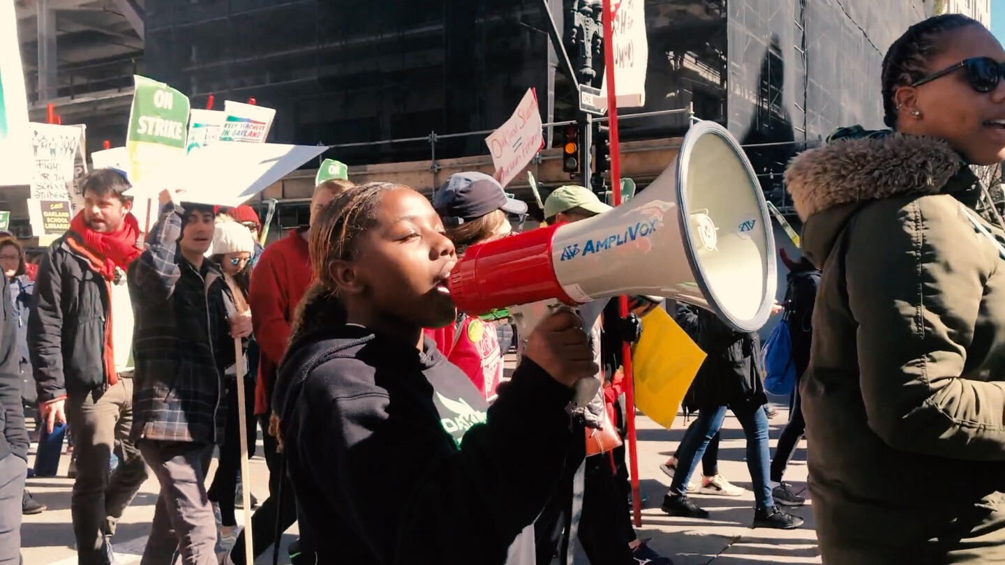 In Oakland, Jae Hill from the organization Youth Together joins teachers' strikes to support funding for pay and to maintain the health and counseling services that she and her fellow students need to succeed in school.