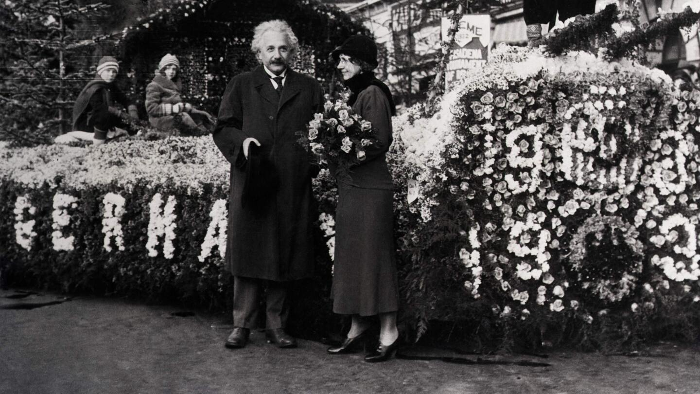 Dr. Albert Einstein took time out from his research to inspect the prize winning float in the 1932 Rose Parade. The float represented a scene in the Black Forest of Germany. | Photo Getty Images / Bettman