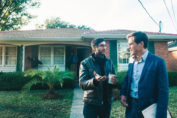 Ramin Bahrani and Michael Shannon on the set of 99 Homes