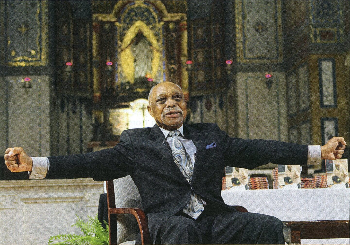 "Rev. Cecil ""Chip"" Murray extending his arms out. 