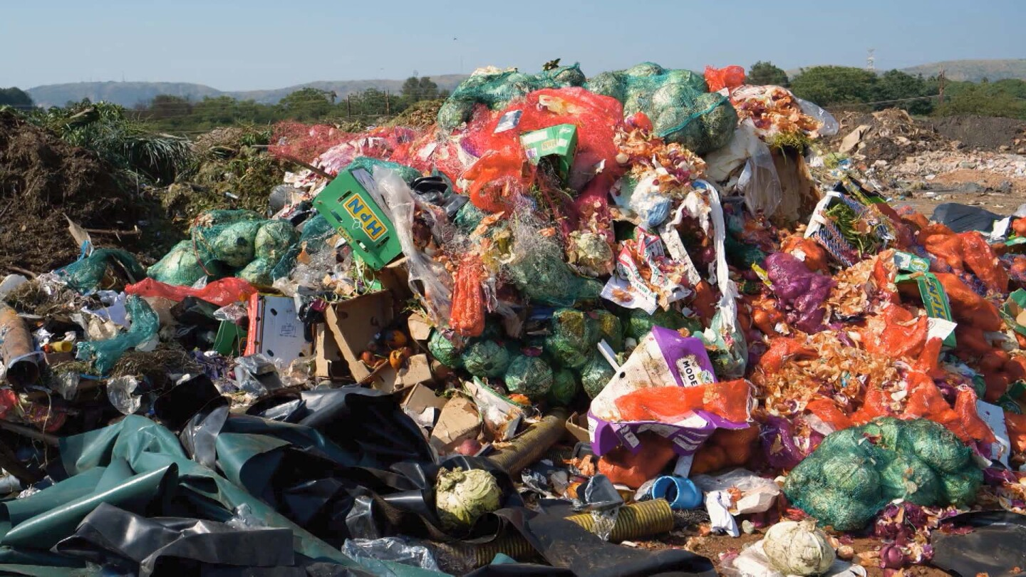 "A mountain of food waste in a landfill. | Still from ""Broken Bread"""