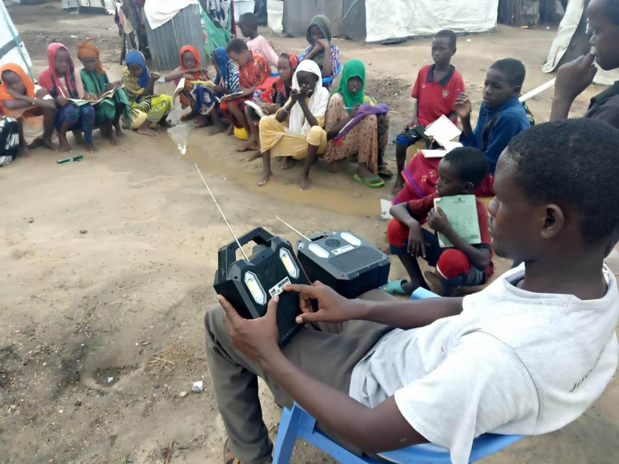 Pupils listen to school lessons broadcast over a solar radio in Dalu village, Tana River County, Kenya, November 28, 2020. | Thomson Reuters Foundation/Benson Rioba