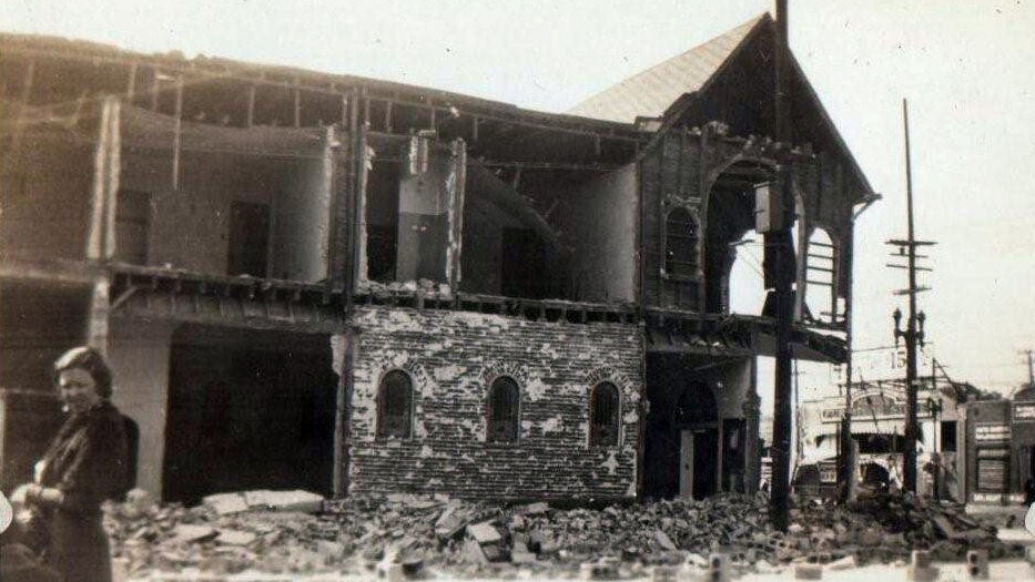 Woman next to rubble after 1933 quake