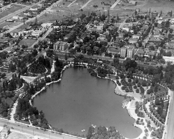 Aerial view of Westlake Park in 1921, before the Wilshire Boulevard causeway split the lake. Courtesy of the Title Insurance and Trust, and C.C. Pierce Photography Collection, USC Libraries.