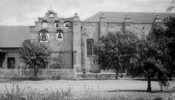 Pepper trees shade the ground outside Mission San Gabriel, ca.1884. Courtesy of the USC Libraries - California Historical Society Collection.
