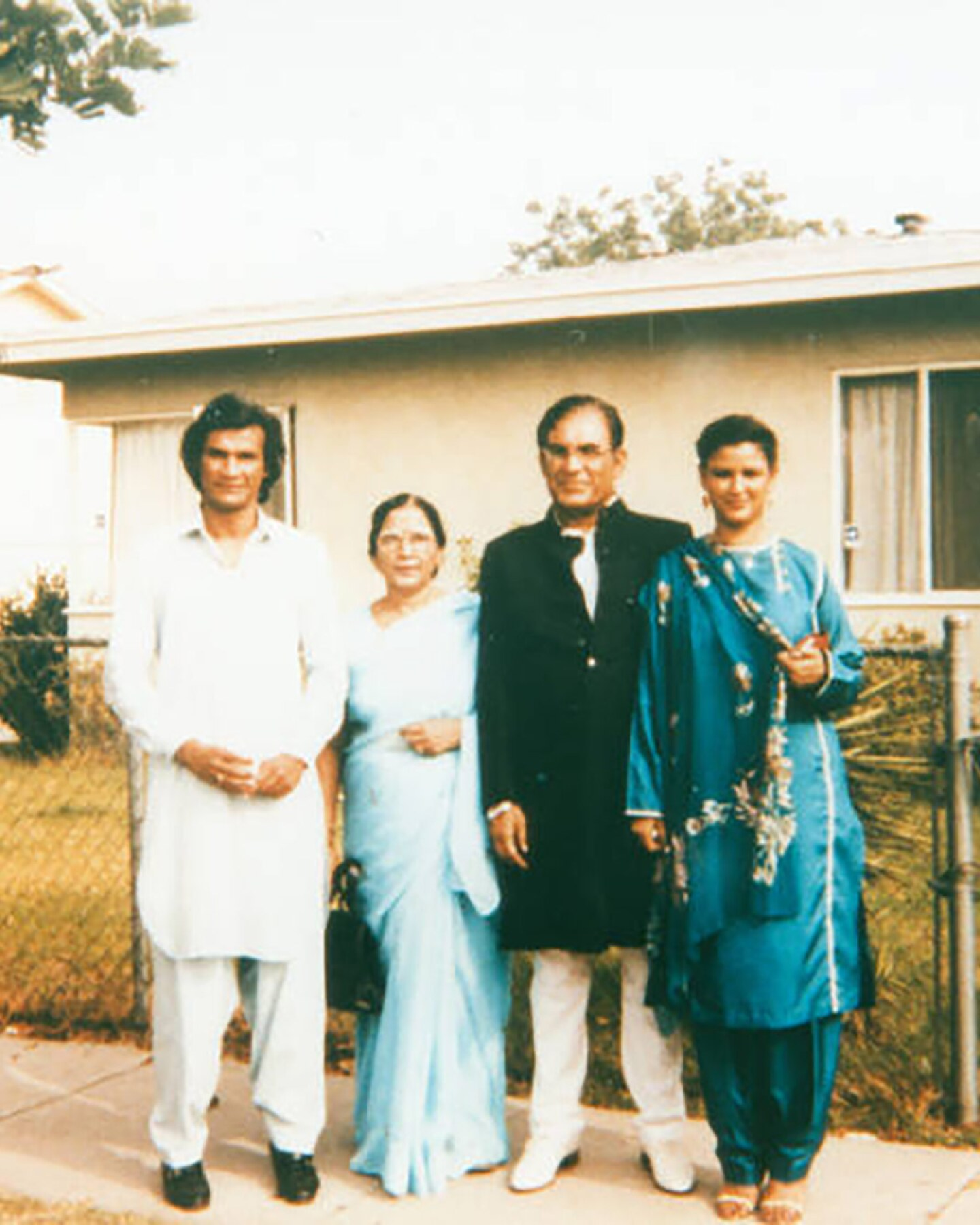 Syed and Qaiser with their children Qamar and Faozia in front of a home in Los Angeles. | Shades of L.A. Collection / LAPL