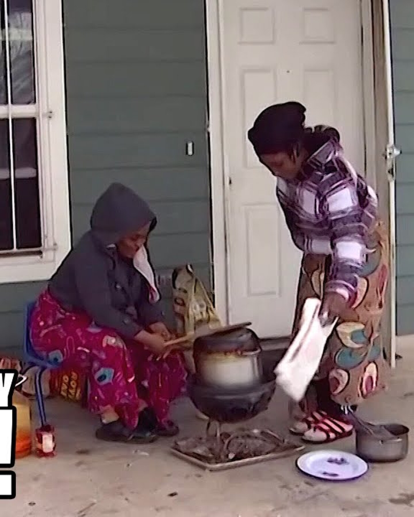 Two people tending to a pot on their porch in Texas.