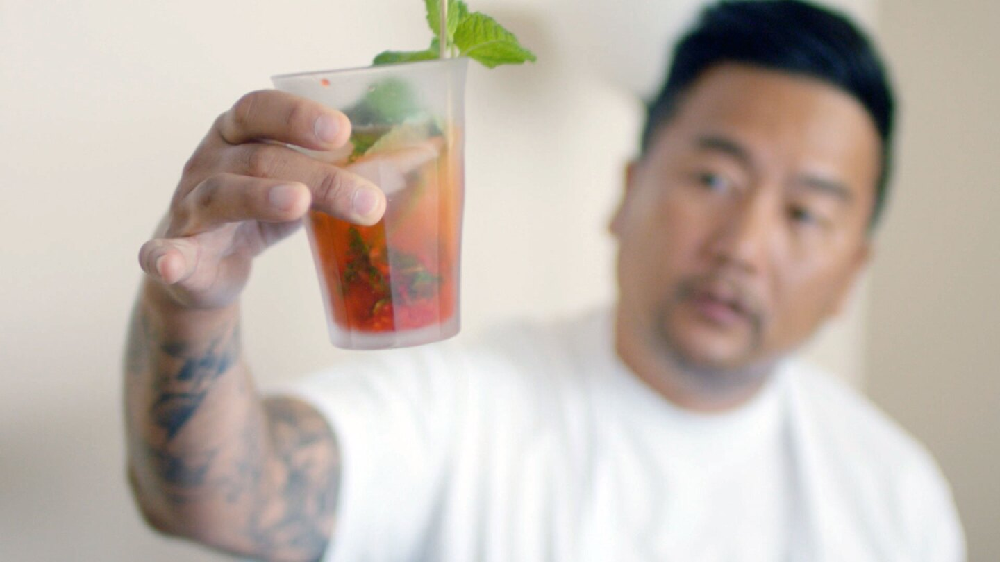 "Roy Choi holds a drink prepared by PopCultivate founder Chris Yang. | Still from ""Broken Bread"