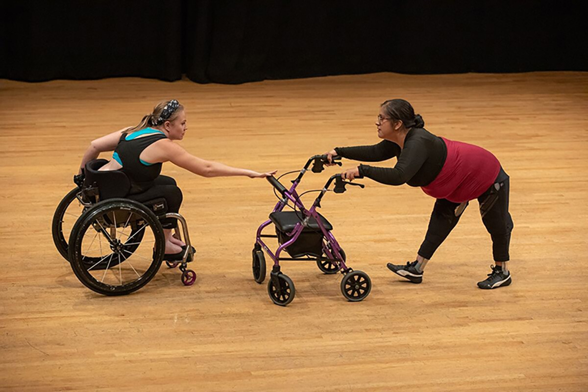 Harmanie Taylor, left, and Vanessa Cruz perform a duet during the Dancing Disability Lab at UCLA.   Reed Hutchinson/UCLA.