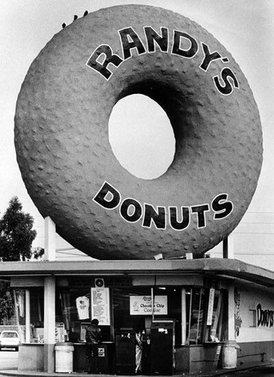Randy's Donuts, located at 805 W. Manchester Boulevard, isn't programmatic architecture, but its oversized signage makes it a memorable commercial landmark | Photograph courtesy of Herald Examiner Collection, Los Angeles Public Library